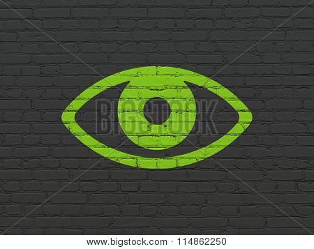 Protection concept: Eye on wall background
