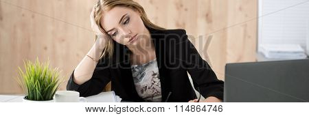 Tired Business Woman Sitting At Her Working Place