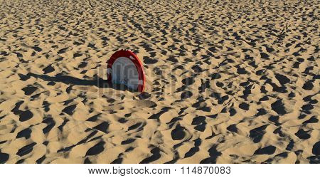 Sign buried in the sand