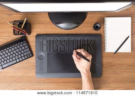 Designer Workspace With Tablet, Keyboard, Computer