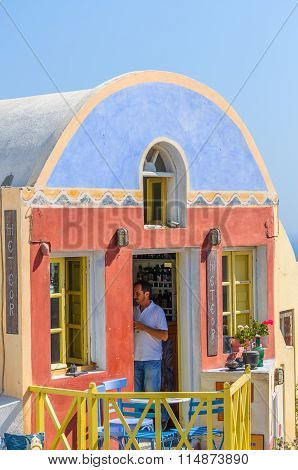 Beautiful souvenir shop and seller in it at Oia town