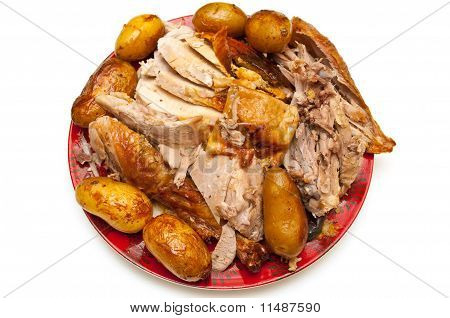 Carved, Sliced Turkey Served With Potatoes Isolated On White