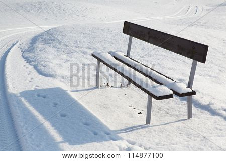 Lonely Bench In A Winter Landscape