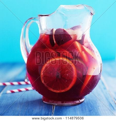 sangria pitcher with fruits on table top