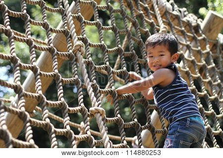 Japanese boy playing with rope ladder (3 years old)