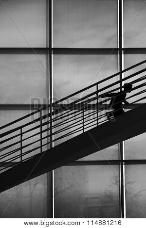 Boy silhouette climbing stairs
