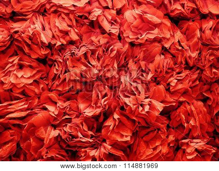background of flowers made from red a crepe paper