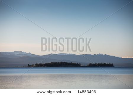Lake Showing The Sky With Clouds And Reflections On Mountains