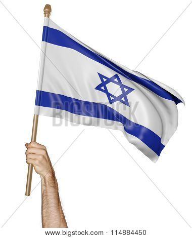Hand proudly waving the national flag of Israel