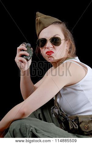 Closeup Portrait Of A Young Pretty Female Model  With  Grenade In Studio