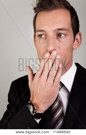 Yawning Young Businessman