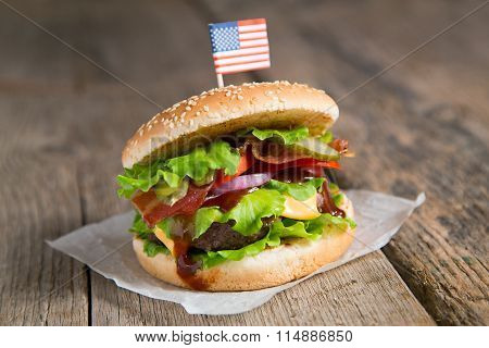 Burger with beef, onion, cheese, barbecue sauce