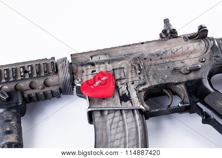 automatic carbine and red heart