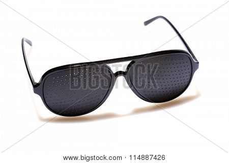Super COOL Black Plastic Pinhole Sunglasses, isolated on white with room for your text. Black Sunglasses are worn by cool people around the world.