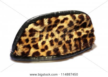 A Genuine REAL Leopard Fur Hat from Africa, isolated on white with room for your text. Leopard and Animal Fur have been a Fashion Statement for thousands of years and perhaps since the dawn of man.
