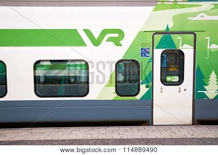 HELSINKI, FINLAND - SEPTEMBER 21, 2014: train at Helsinki Central railway station. It is a widely recognised landmark in Kluuvi, part of central Helsinki, Finland