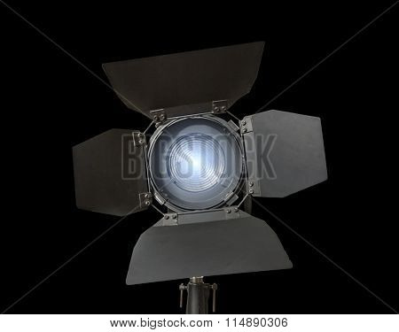 Spotlight fixture glowing used in film and theater productions  isolated on black background