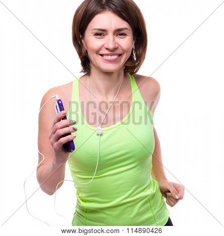 smiling woman with mobilephone and earphones on training