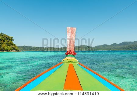 Tropical beach longtail boats Andaman Sea in Phuket Thailand