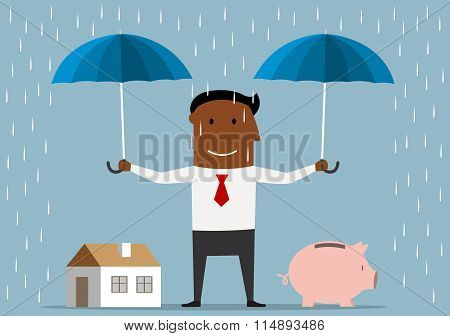 Businessman protecting house and piggy bank