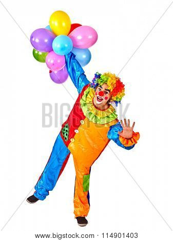 Happy cheerful birthday  male clown holding  bunch of balloons.  Isolated.