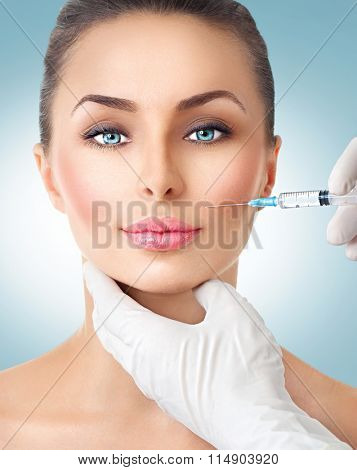 Beautiful woman gets beauty facial injections. Face aging injection. Aesthetic Medicine, Cosmetology