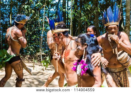 Native Brazilian dancing at an indigenous tribe in the Amazon