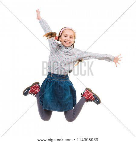 photo of joyful little girl jumping isolated on white background