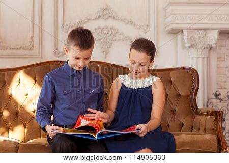 Boy and girl read book