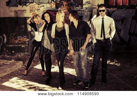 Group of young fashion men and women