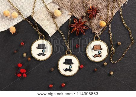 Handmade cross stitch pendant