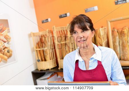 Lady serving in bakery