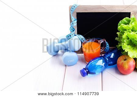 fitness frame with dumbbells and fruits copy space - beauty and sport