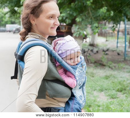 The young woman with the child on sling