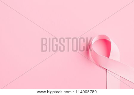 pink ribbon breast cancer on pink background