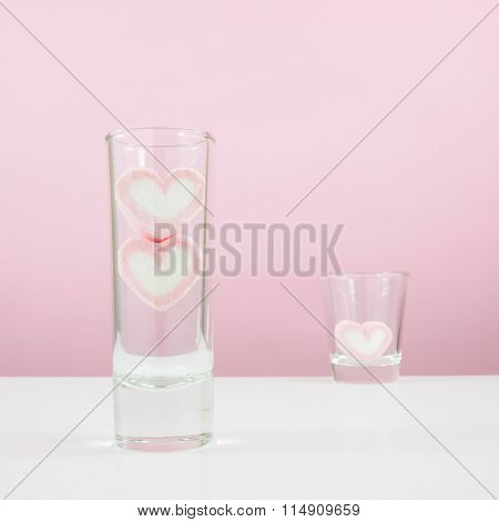 The lovely pink heart marshmallows in small narrow glass and shot glass