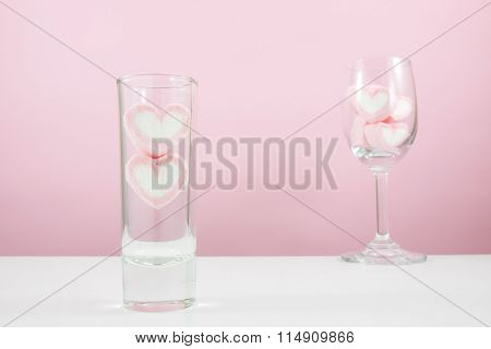 The lovely pink heart marshmallows in small narrow glass and wine glass