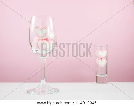 The lovely pink heart marshmallows in wine glass and small narrow glass
