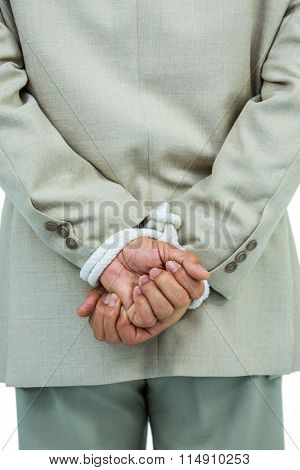 Businessman tied up in rope on white background