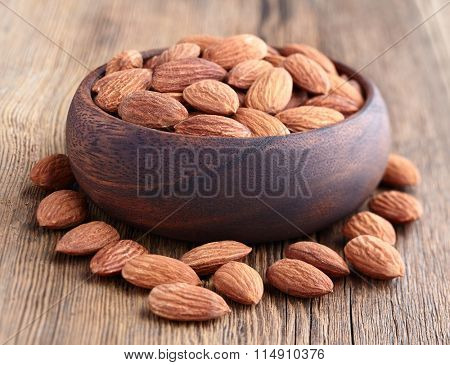 Almonds kernel on a wooden background