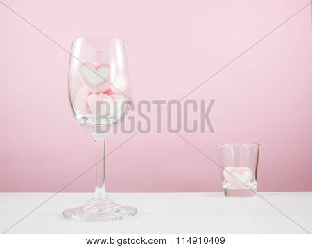 The lovely pink heart marshmallows in wine glass and shot glass