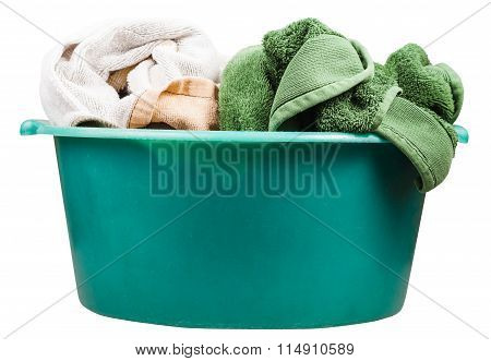 Side View Of Round Green Wash Basin With Towels