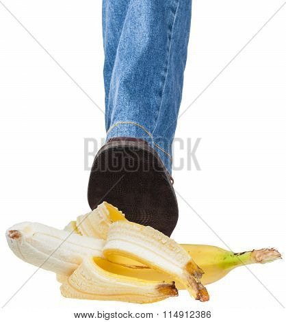 Left Foot In Jeans And Shoe Stepping On Banana