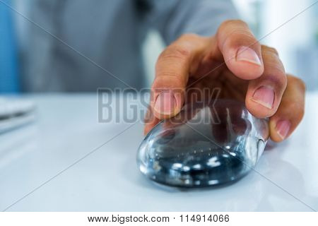 Businessman using the mouse in an office