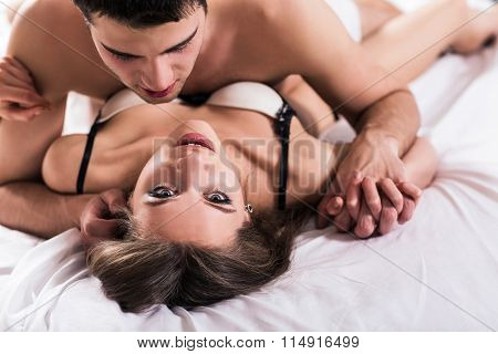 Young romantic couple hugging and kissing