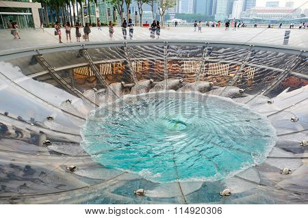 SINGAPORE - NOVEMBER 08, 2015: view of Rain Oculus. Rain Oculus is a large whirlpool forms inside a 70 foot diameter acrylic bowl and falls 2 stories to a pool below
