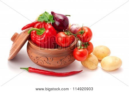 Vegetables Stacked In A Clay Pot