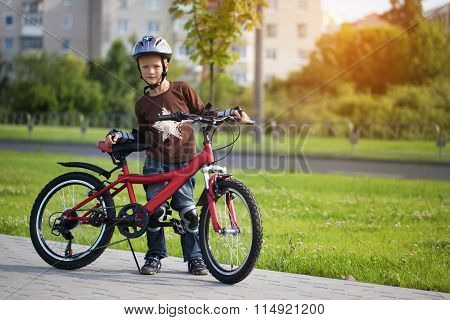 Happy Boy Cycling At The Park In The Afternoon.