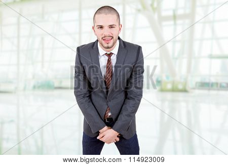 young silly business man portrait at the office