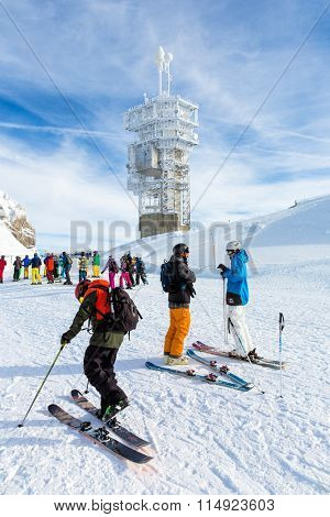 ENGELBERG, SWITZERLAND. January 18th, 2016. Skiers preparing for a downhill run from the top of Mount Titlis at minus 12 degrees Celsius.